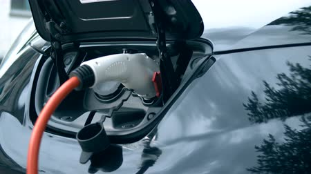 reloading : Electrical fuel nozzle is charging a car