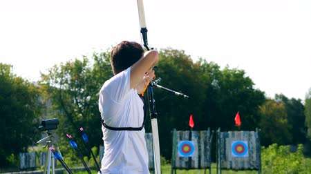 targeting : A man is preparing to shoot from the bow. Archery shooting. Stock Footage