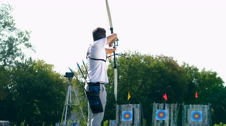 targeting : Male archer is using the bow to aim. Archery shooting.