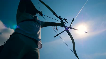 targeting : Sunlit sky and an archer in the process of aiming