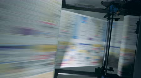 nakladatelství : Newspaper moving on a line in a printing office.