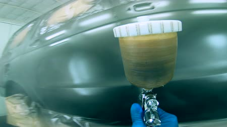 pneumatic : Car is getting dyed into metallic with the sprayer Stock Footage