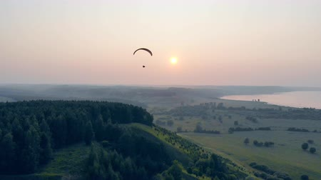 parachuting : Sailwing is drifting high in the sunlit sky. Paraglider in the sky.