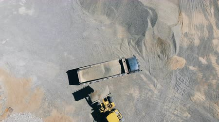 грузовики : Top view of extracted rubble getting transported Стоковые видеозаписи