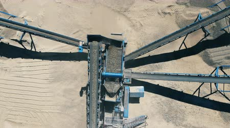 kazılmış : Grinding process of excavated gravel in a top view. Mining Excavation equiipment.