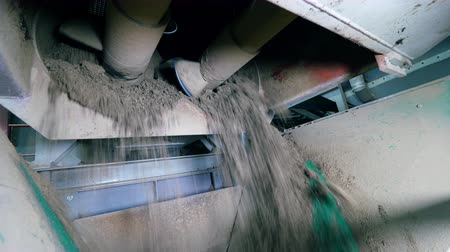 mechanically : Dry concrete is getting mechanically processed