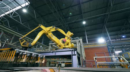 automate : Robotic Arm production line at a modern factory line.