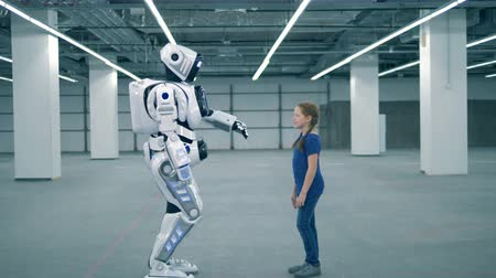 invenção : Concept of future. White robot and girl touching hands, side view. Vídeos
