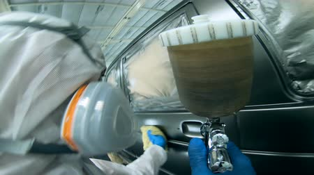 compressor : Worker is wiping a freshly-coloured car Stock Footage