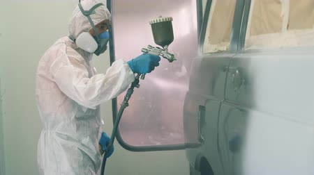dyeing : Automobile is being painted by the mechanic Stock Footage