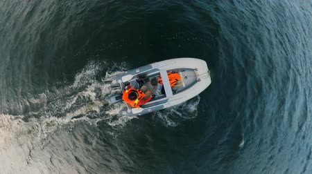 моторная лодка : Top view of a person swimming in a dinghy Стоковые видеозаписи