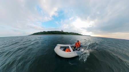 tiller : A person in a powerboat is moving across the water Stock Footage