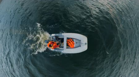 tiller : Top view of an inflatable vessel moving along the river