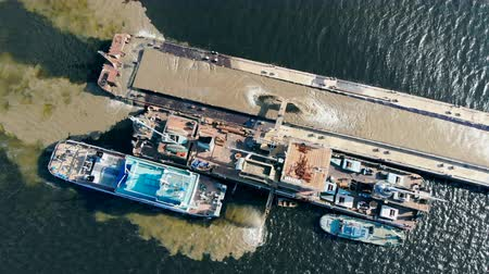 dredging : Top view of dredging boats getting sand from the water Stock Footage