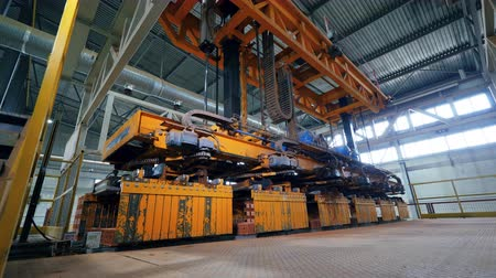 brick factory : Industrial conveyor removing brick blocks. Automatic robot manipulator in factory.
