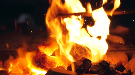 rabble : Coals in the fire are getting mingle with a rabble Stock Footage