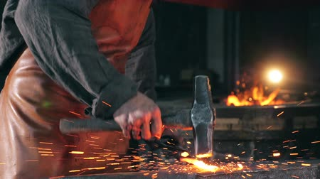 inflamed : Forgeman is hammering metal in slow motion Stock Footage