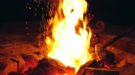 rabble : Slow motion shuffling of coals inside of the fire
