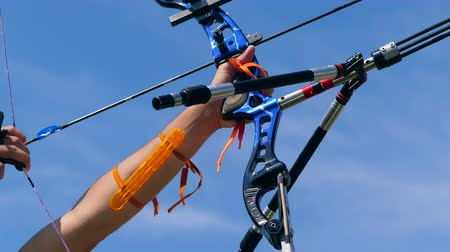 focus pull : Sportsman pulls an arrow in a bow.