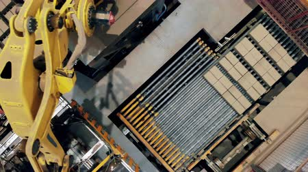 brick factory : Big machine moves yellow bricks on a factory conveyor.