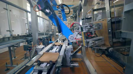 complex system : Carton boxes are getting made and relocated by the machine