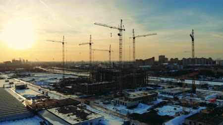 kader : Urban construction site with building cranes