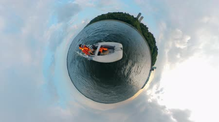 моторная лодка : Young man sailing a white boat on river. Man floats on a motorboat