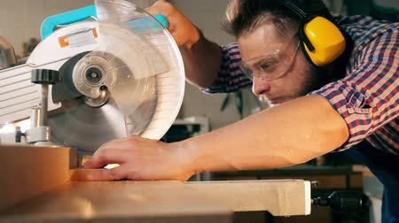 marangoz : Slow motion wood cutting held by the craftsman with a rotary saw