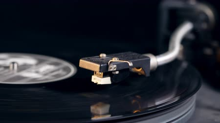 gramophone : Stylus is getting lowered onto the vinyl disc Stock Footage
