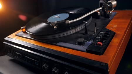 gramophone : Vinyl disc is getting taken off from the turntable