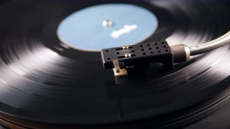 vinyl record : Close up of the stylus getting put onto the record Stock Footage