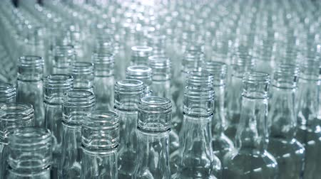 piled up : Massive amount of glass bottles are moving closely to each other