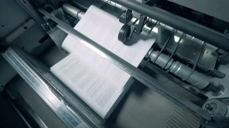 ofset : Printing office machine stacks white paper. Dostupné videozáznamy