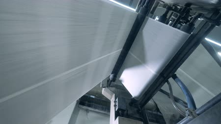 kartka papieru : Rollers move printed sheets on a line in a typography room. Wideo