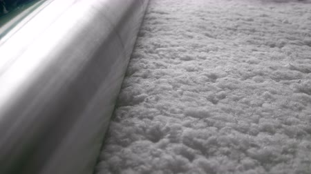 sintético : Cotton wool is slowly moving towards the roller Stock Footage