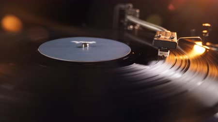 tonearm : Rotating vinyl record scratched with a metal needle on a gramophone. Stock Footage