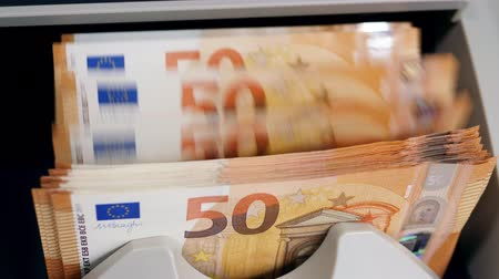 euro banknotes : Cash money checked in a counting machine at a bank.