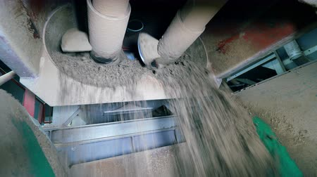 mechanically : Dry cement is getting mechanically stirred
