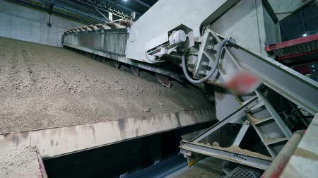 mechanically : Factory machine is planarizing dry cement