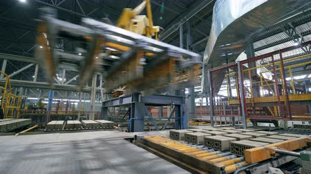 brick factory : Automated machine moves bricks on a working conveyor. Stock Footage