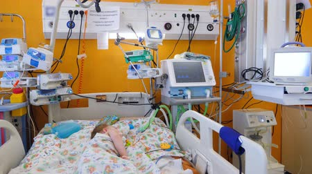 neonatology : A little patient sleeps in a modern ward with medical equipment.