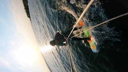 kitesurfer : Kitesurfer is getting back onto the board after the falling
