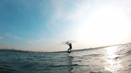 kiting : Kitesurfing of a man along the river waters