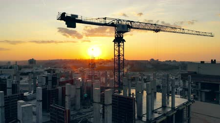 inacabado : Urban construction site with cranes at sunset Stock Footage