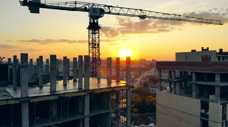 inacabado : Urban buildings are getting constructed at sunset