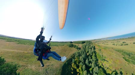 hang gliding : People gliding in the sky with a paraplane.