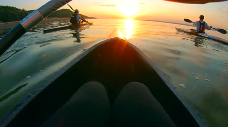 canoes : First-person view of a paddler taking part in a race on the lake