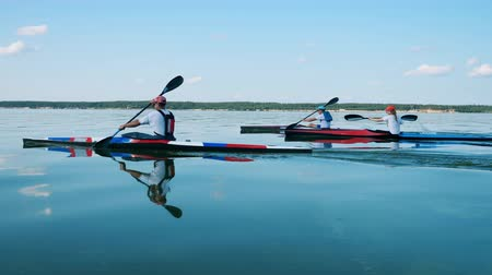 navigating : Rowing competition held at the lake in slow motion Stock Footage
