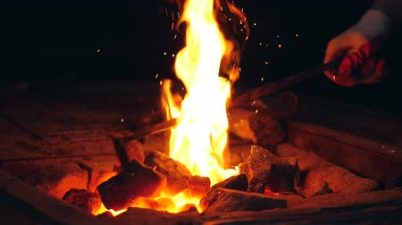 rabble : Mingling of burning coals in slow motion