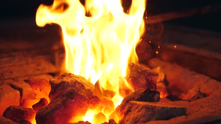 rabble : Slow motion of a rabble shuffling burning coals Stock Footage
